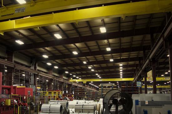 A dimly lit warehouse before LED retrofitting
