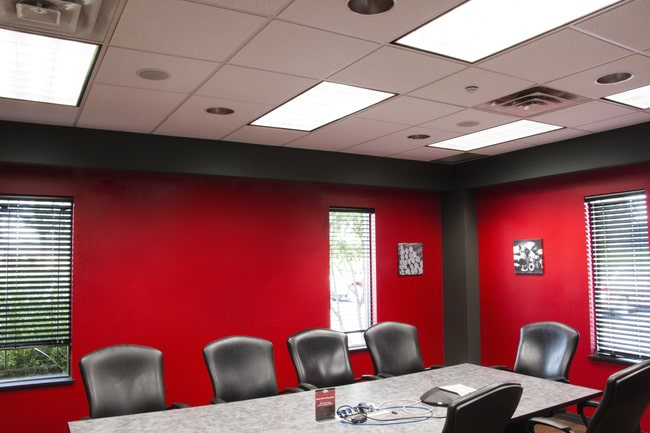 Rectangular shaped LED Troffer Lights illuminating a commercial conference room space