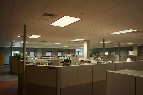 A dimly lit office building with old fluorescent lighting