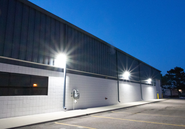 LED wall pack fixtures on the side of a building providing bright outdoor lighting
