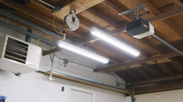 A suspended low bay fixture in a commercial garage