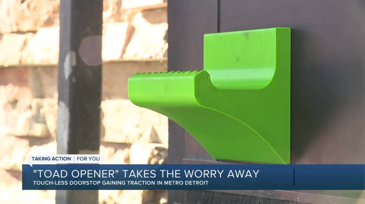 News story about a green hands-free foot operated door opener known as 'the toad opener'